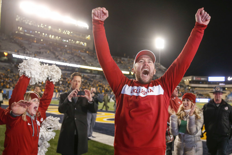 Photo - Oklahoma Sooners head coach Lincoln Riley yells in excitement after his team's win over the West Virginia Mountaineers at Mountaineer Field at Milan Puskar Stadium in Morgantown, W.Va on Friday, November 23, 2018. The 59-56 win clinched Oklahoma a place in the Big 12 championship game against Texas. IAN MAULE/Tulsa World