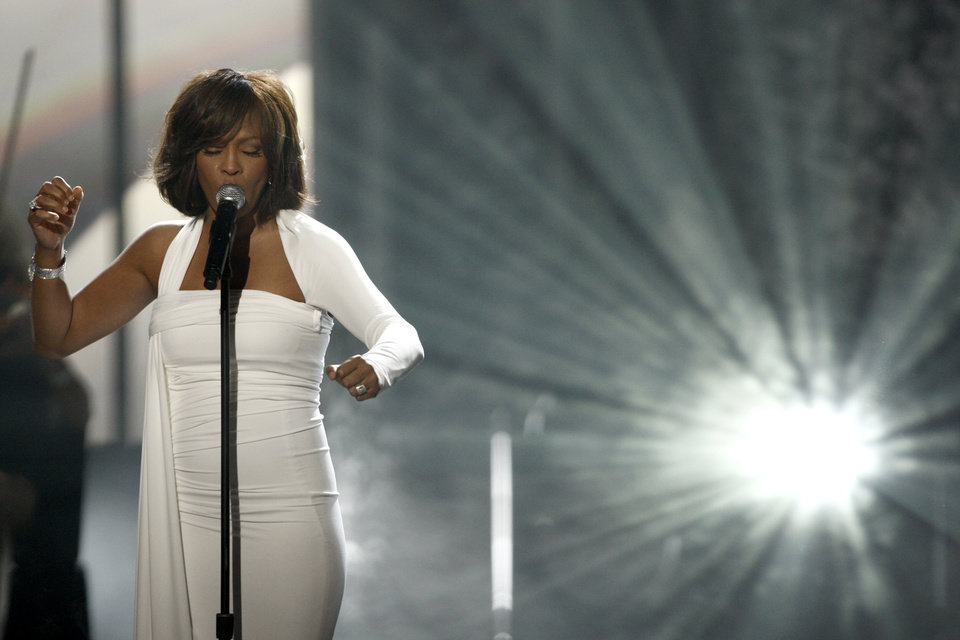 In this Nov. 22, 2009, file photo, Whitney Houston performs at the 37th Annual American Music Awards in Los Angeles. Houston died Saturday, Feb. 11, 2012, she was 48. (AP Photo/Matt Sayles) ORG XMIT: NY123
