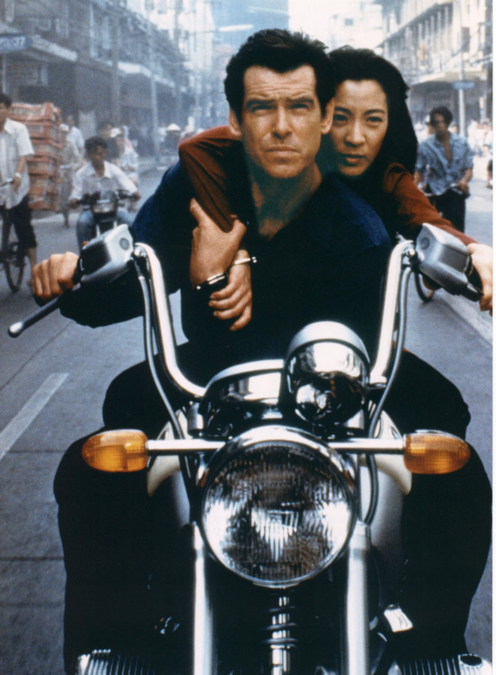 "FILE - This undated publicity file photo provided by BMW, shows Pierce Brosnan, as Bond, and Michelle Yeoh, as the Bond-girl, Wai Lin, in a scene from the James Bond 1997 movie ""Tomorrow Never Dies."" Who qualifies as a Bond girl has also changed over the years, as the blue-eyed, buxom blonde has given way to more diverse leading ladies, including Michelle Yeoh (�Tomorrow Never Dies�) and Halle Berry (�Die Another Day�). Modern Bond girls also present a more formidable challenge to the suave secret agent. (AP Photo/BMW)"