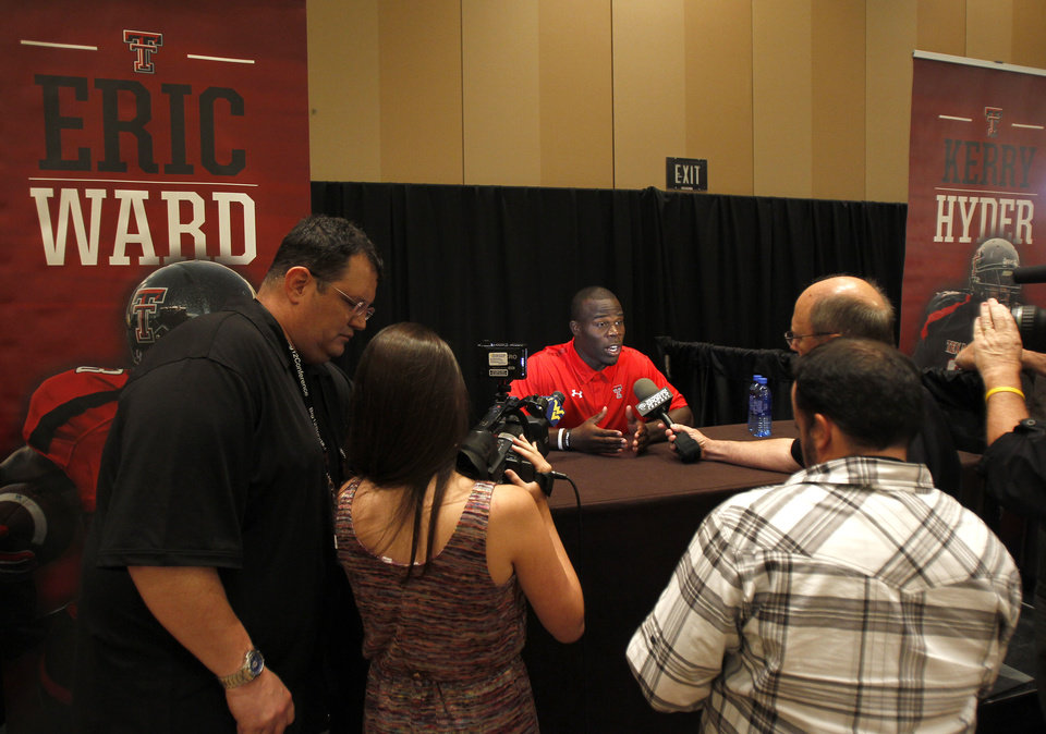 Texas Tech wide receiver Eric Ward conducts interviews during a breakout session at the Big 12 Conference Football Media Days Monday, July 22, 2013 in Dallas.  (AP Photo/Tim Sharp)