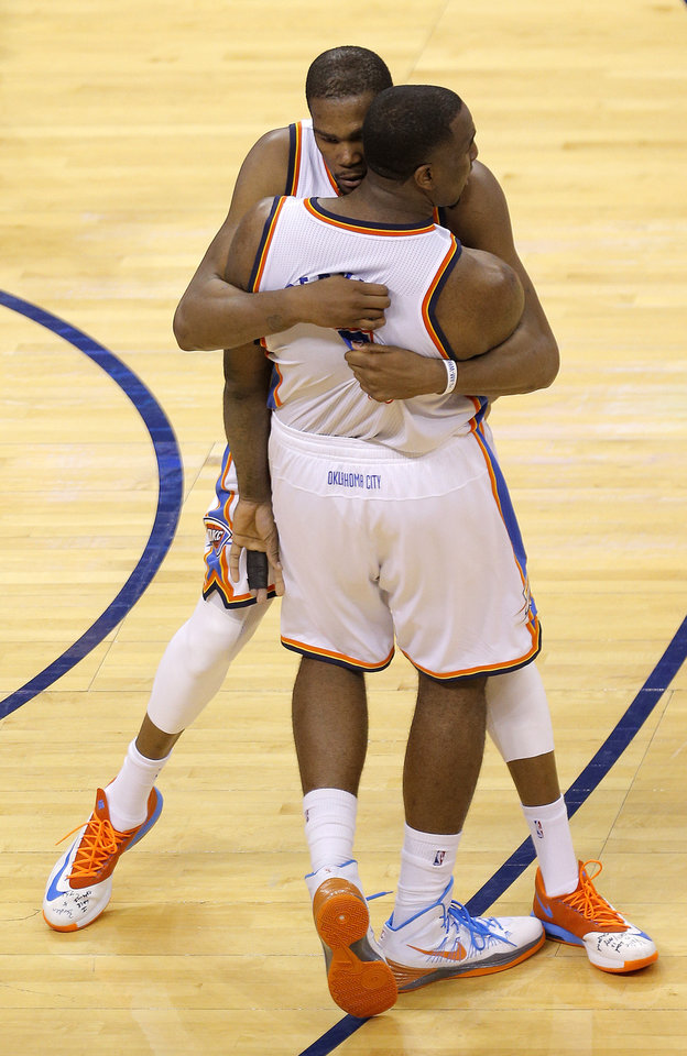 Photo - Oklahoma City's Kevin Durant (35) hugs Kendrick Perkins (5) after Perkins tied the game during Game 2 in the first round of the NBA playoffs between the Oklahoma City Thunder and the Memphis Grizzlies at Chesapeake Energy Arena in Oklahoma City, Monday, April 21, 2014. Photo by Sarah Phipps, The Oklahoman