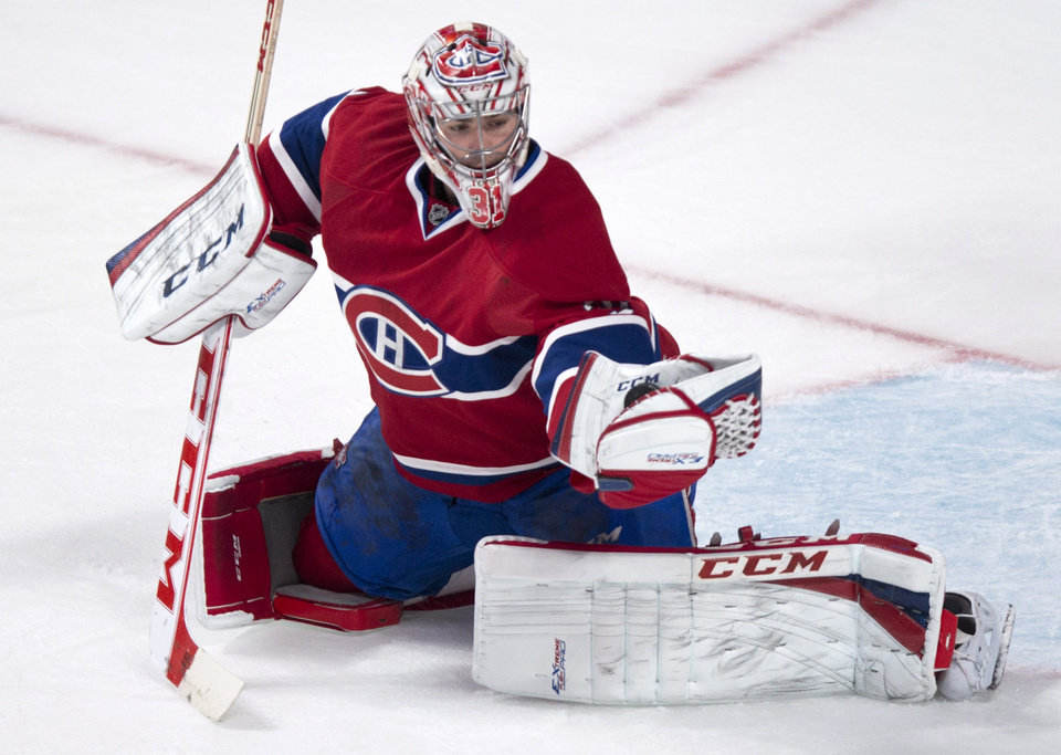 Photo - Montreal Canadiens goalie Carey Price makes a glove save as they face the Boston Bruins during first period NHL hockey action Thursday, Dec. 5, 2013, in Montreal. (AP Photo/The Canadian Press, Paul Chiasson)cptor