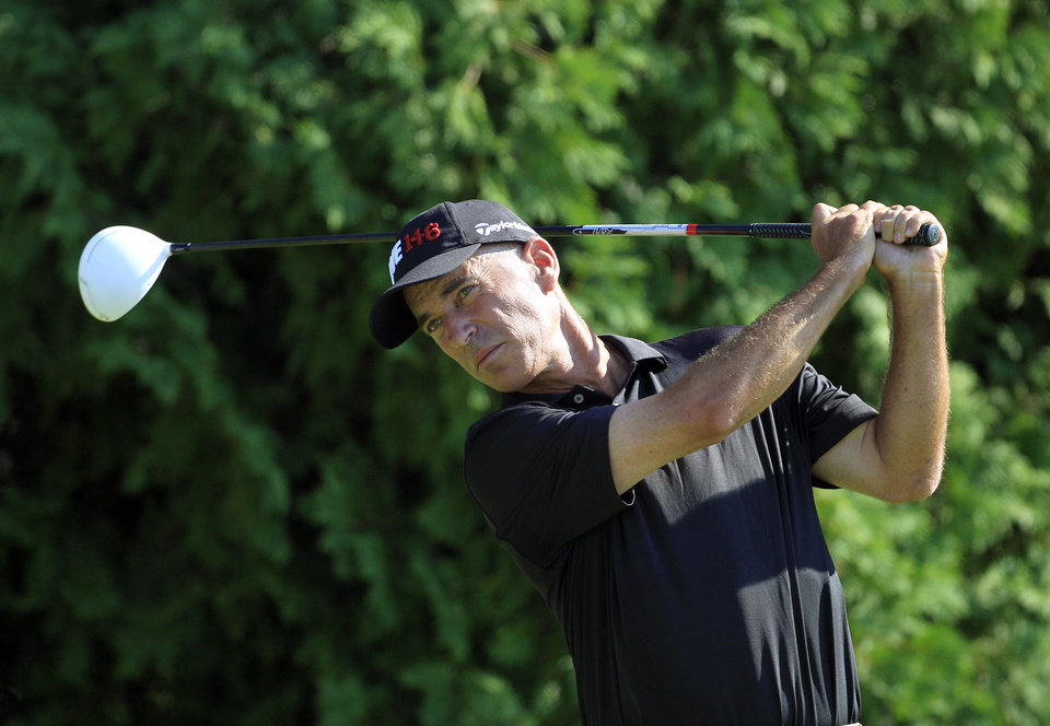 Photo -   Corey Pavin drives on the sixth hole during the first round at the U.S. Senior Open golf tournament at the Indianwood Golf and Country Club in Lake Orion, Mich., Thursday, July 12, 2012. (AP Photo/Carlos Osorio)