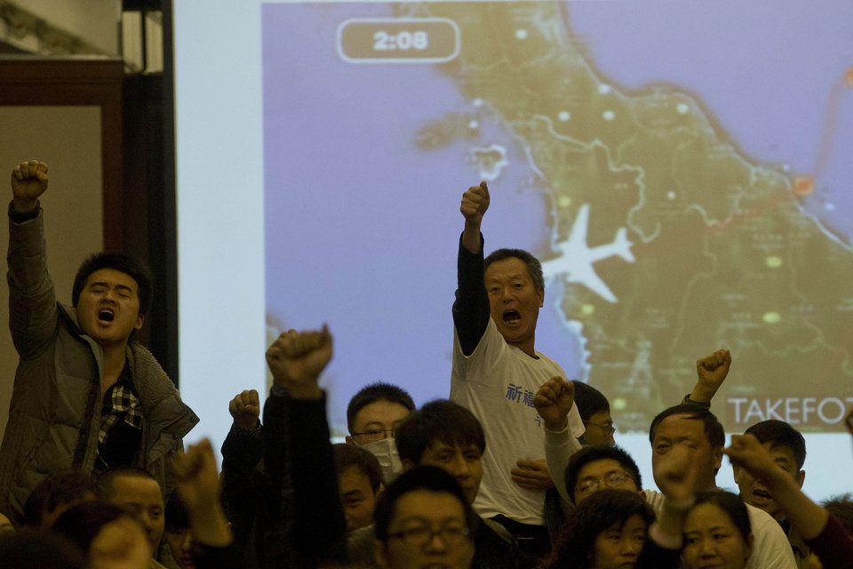 Photo - Relatives of Chinese passengers aboard the missing Malaysia Airlines, flight MH370, turn to journalists to shout their demands for answers after Malaysian government representatives left a briefing in Beijing, China. Authorities have been forced on the defensive by the criticism, the most forceful of which has come from a group of Chinese relatives who accuse them of lying about - or even involvement in - the disappearance of Flight 370. (AP Photo/Ng Han Guan, File)