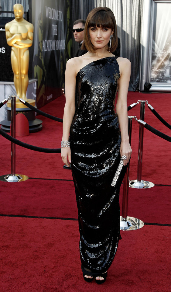 Rose Byrne arrives before the 84th Academy Awards on Sunday, Feb. 26, 2012, in the Hollywood section of Los Angeles. (AP Photo/Matt Sayles) ORG XMIT: OSC252