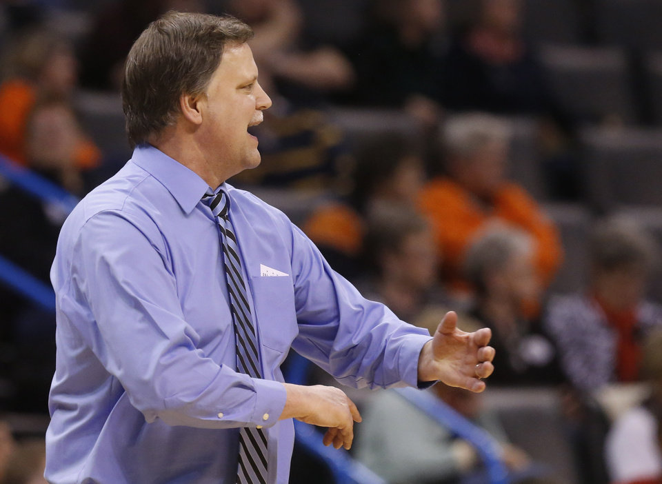 Photo - West Virginia head coach Mike Carey gestures in the second half of an NCAA college basketball game against Texas in the semifinals of the Big 12 Conference women's tournament in Oklahoma City, Sunday, March 9, 2014. West Virginia won 67-60. (AP Photo/Sue Ogrocki)