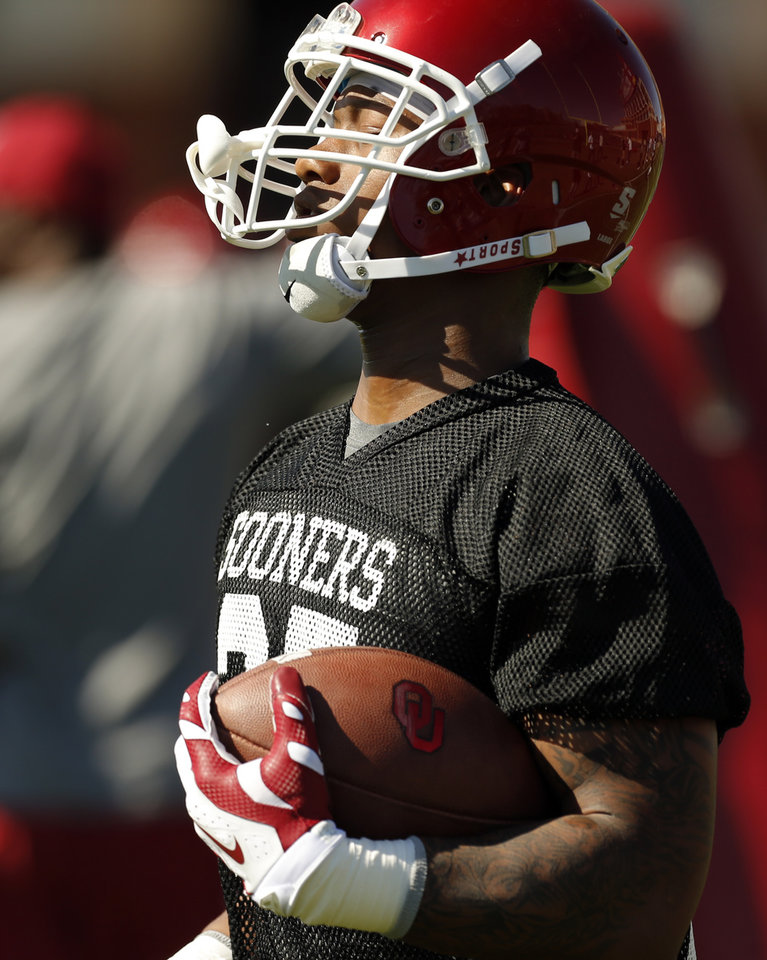 Photo - OU's Joe Mixon (25) runs after making a catch during a drill at spring football practice for the University of Oklahoma Sooners in Norman, Okla., Monday, March 23, 2015. Photo by Nate Billings, The Oklahoman
