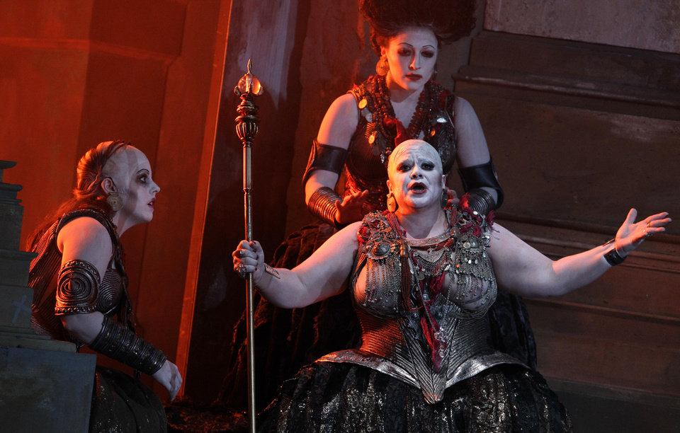 "In this photo taken Tuesday, Oct. 2, 2012, in Chicago, Emily Birsan as Trainbearer, left, Jill Grove as Klyamnestra, with sceptor, and Kiri Deonarine as Confidante, top right, perform during the first act of a dress rehearsal of the Lyric Opera of Chicago's new production of ""Elektra."" (AP Photo/M. Spencer Green)"