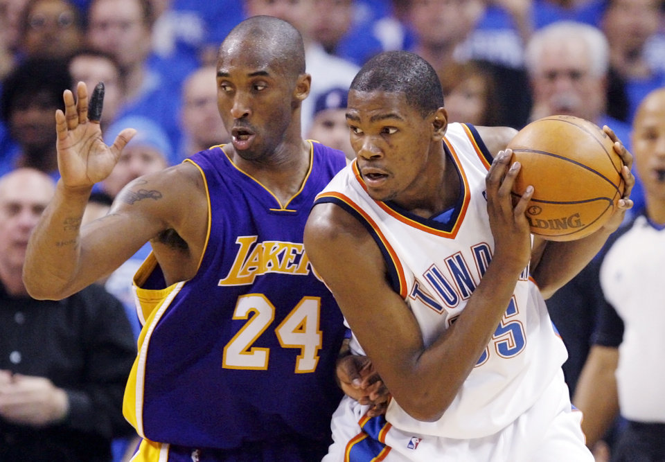 Photo - GAME THREE / L.A. LAKERS: Oklahoma City's Kevin Durant (35) looks to get the ball past Kobe Bryant (24) of L.A. during the NBA basketball game between the Los Angeles Lakers and the Oklahoma City Thunder in the first round of the NBA playoffs at the Ford Center in Oklahoma City, Thursday, April 22, 2010. Oklahoma City won, 101-96. Photo by Nate Billings, The Oklahoman ORG XMIT: KOD