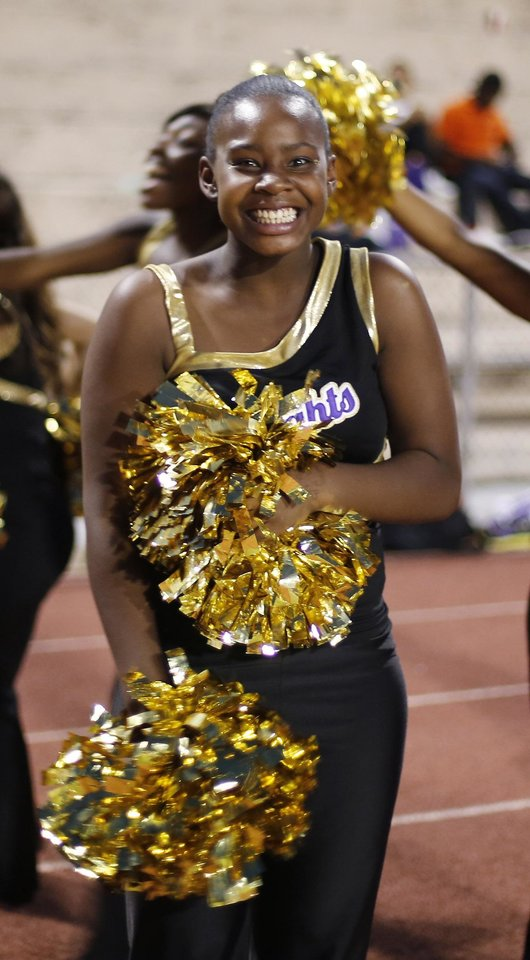 NWC cheerleader reacts to a Knight touchdown  at the Northwest Classen vs. Western Heights high school football game at Taft Stadium Thursday, September 20, 2012. Photo by Doug Hoke, The Oklahoman