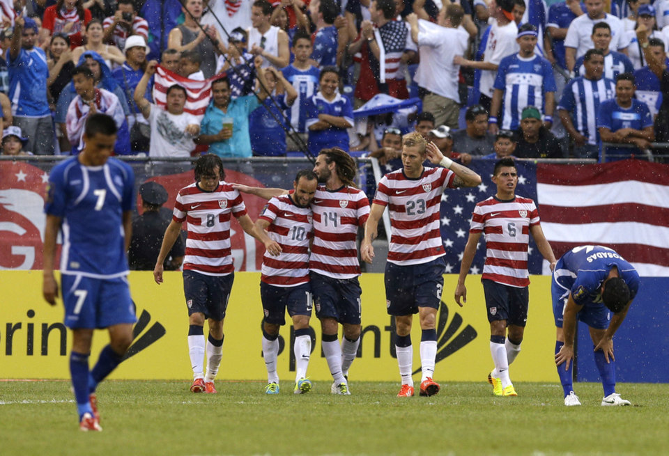Photo - United States teammates celebrate a goal by Mix Diskerud (8) against El Salvador during the second half in the quarterfinals of the CONCACAF Gold Cup soccer tournament on Sunday, July 21, 2013, in Baltimore. The United States won 5-1. (AP Photo/Patrick Semansky)