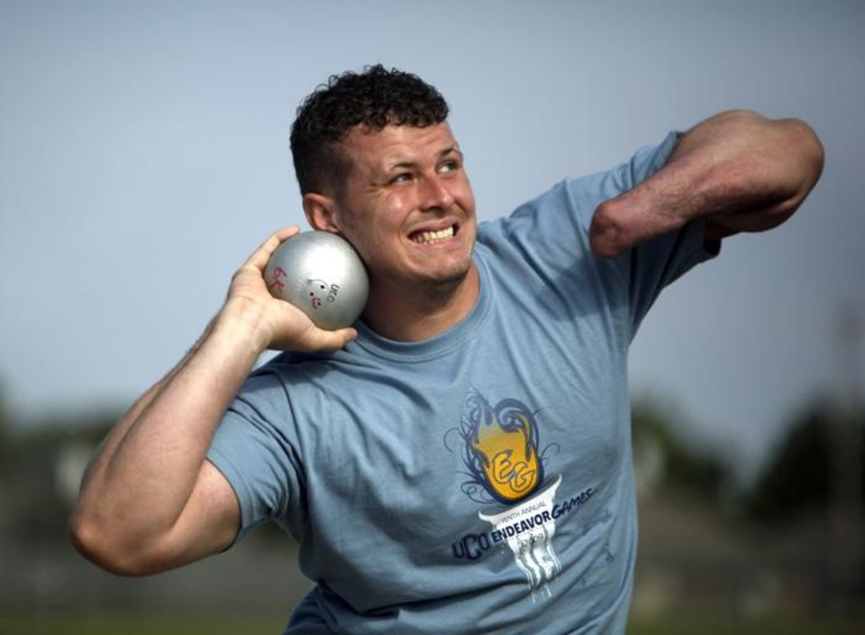 Photo -  Randy Moore of San Antonio, Texas, throws the shot put during the 10th annual Endeavor Games at Edmond North High School in Edmond, Okla., Sunday, June 14, 2009. Photo by Sarah Phipps, The Oklahoman ORG XMIT: KOD