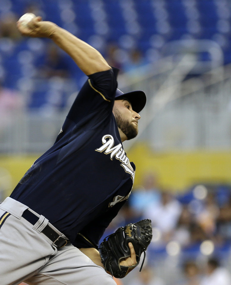 Photo - Milwaukee Brewers' Marco Estrada pitches against the Miami Marlins in the first inning of a baseball game in Miami, Friday, May 23, 2014. (AP Photo/Alan Diaz)