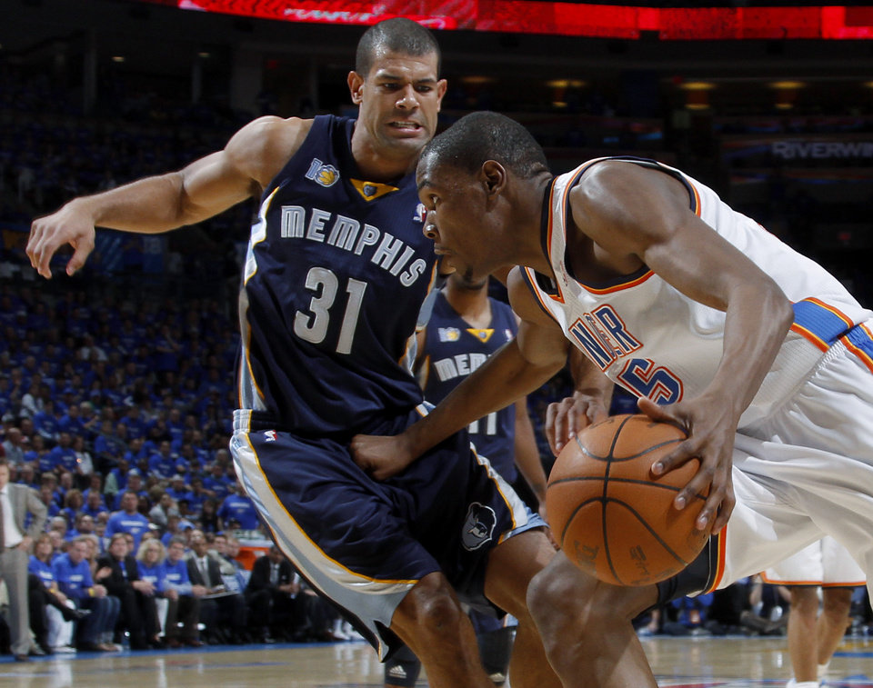 Photo - Oklahoma City's Kevin Durant (35) tries to get past Shane Battier (31) of Memphi during game two of the Western Conference semifinals between the Memphis Grizzlies and the Oklahoma City Thunder in the NBA basketball playoffs at Oklahoma City Arena in Oklahoma City, Tuesday, May 3, 2011. Photo by Bryan Terry, The Oklahoman