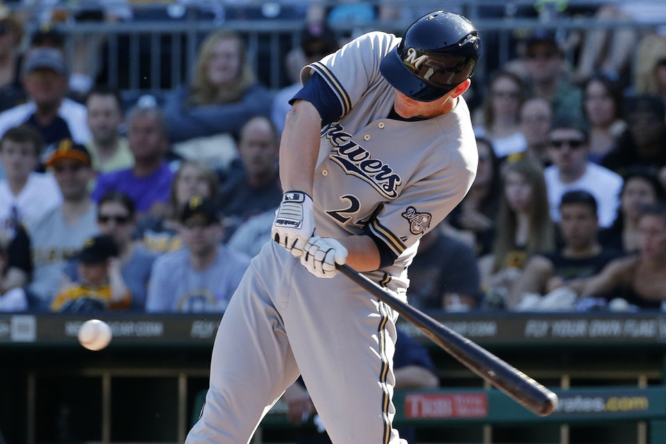 Photo - Milwaukee Brewers' Lyle Overbay (24) drives in two runs with a single off Pittsburgh Pirates starting pitcher Edinson Volquez during the fourth inning of a baseball game in Pittsburgh Saturday, June 7, 2014. (AP Photo/Gene J. Puskar)