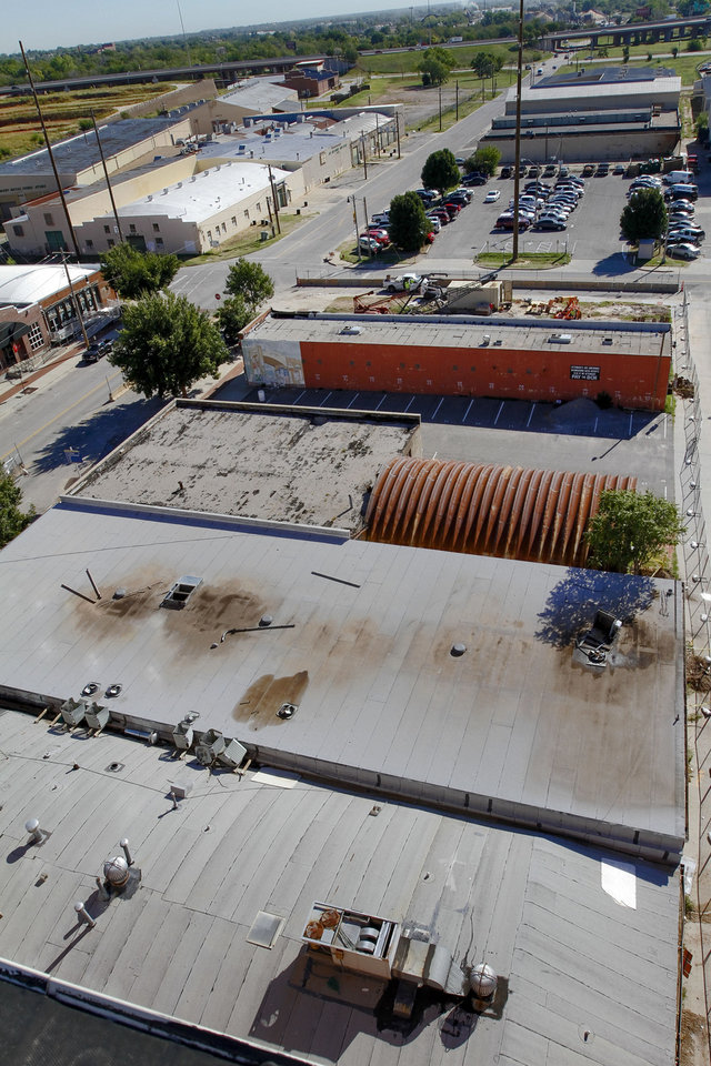 Photo - The buildings shown soon will be razed to make way for a new 11-story hotel tower being built by Sheridan Lodging Partners.  PHOTO BY CHRIS LANDSBERGER, THE OKLAHOMAN