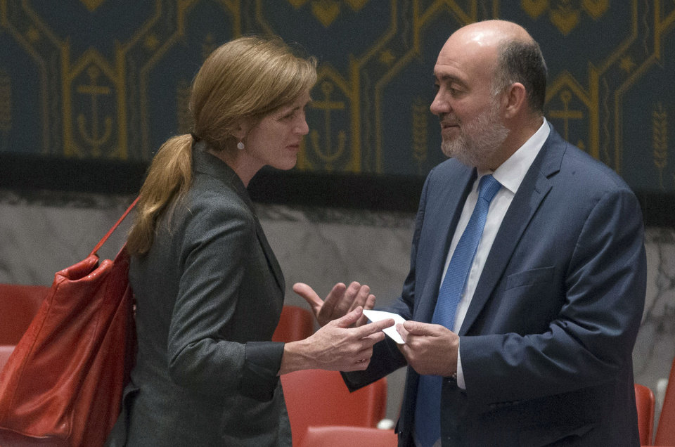 Photo - Israeli U.N. Ambassador Ron Prosor, right, speaks with United States U.N. Ambassador Samantha Power during a meeting of the U.N. Security Council on the worsening situation in Gaza at United Nations headquarters, Monday, July 28, 2014. The U.N. Security Council called for