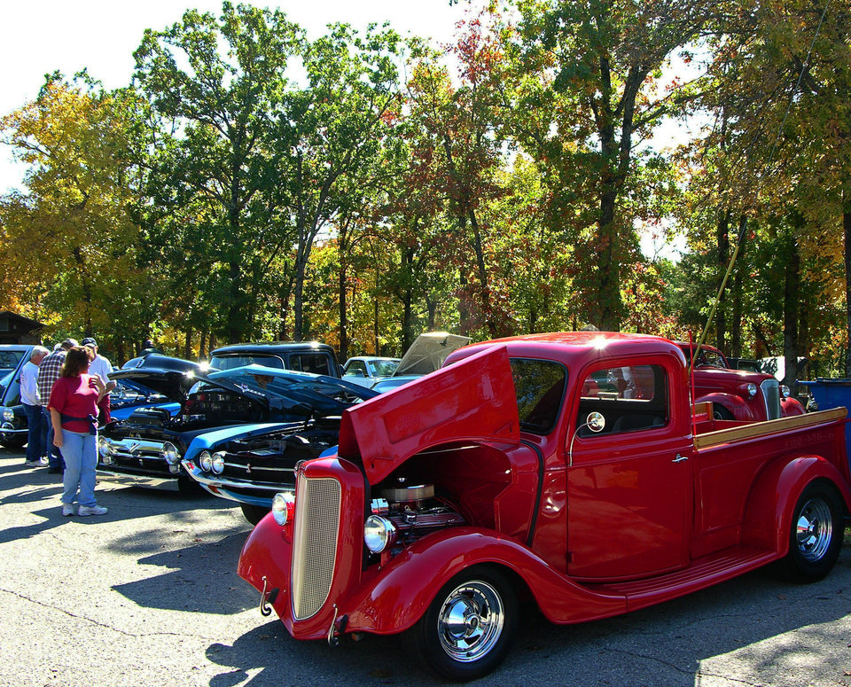 Visitors check out classic cars on display at the Robbers Cave Fall Festival. PHOTO PROVIDED. <strong></strong>