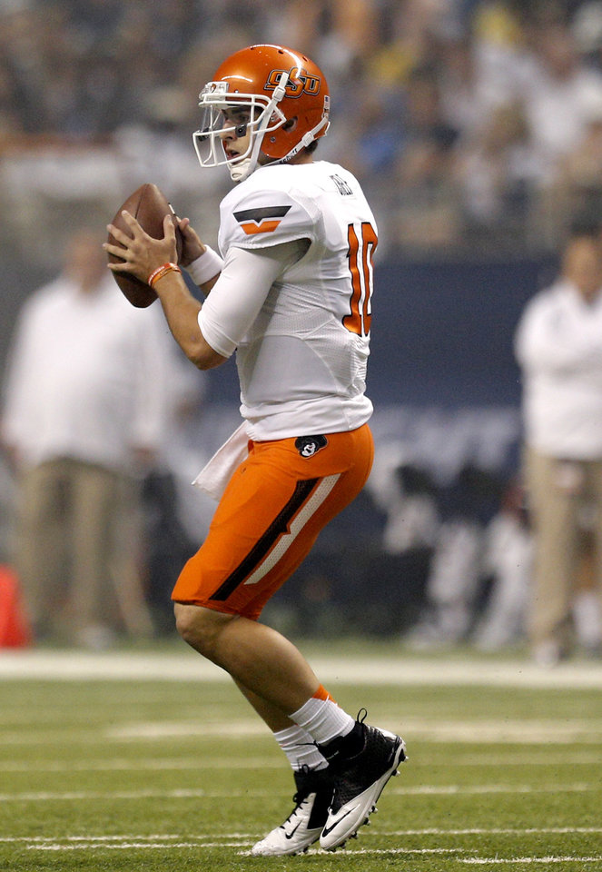 Oklahoma State's Clint Chelf (10) looks to throw during the second half of a college football game between the University of Texas at San Antonio Roadrunners (UTSA) and the Oklahoma State University Cowboys (OSU) at the Alamodome in San Antonio, Saturday, Sept. 7, 2013.  Photo by Sarah Phipps, The Oklahoman