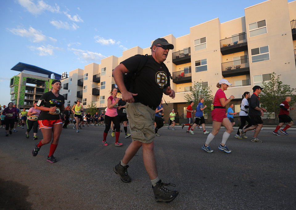 Runners travel north on Walnut Ave. during the Oklahoma City Memorial Marathon in Oklahoma City, Sunday, April 28, 2013.  Photo by Garett Fisbeck, For The Oklahoman