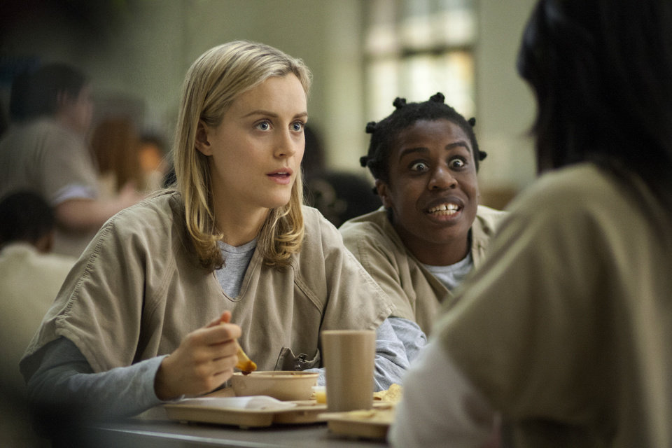 Photo - FILE - This image released by Netflix shows Taylor Schilling, left, and Uzo Aduba in a scene from