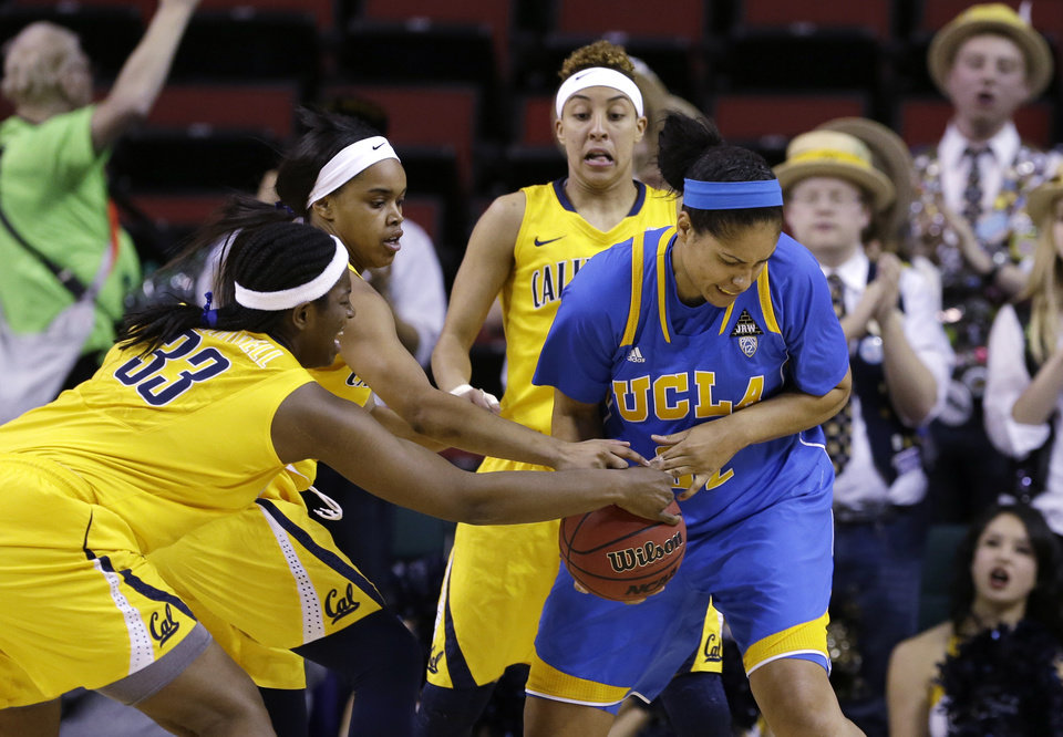 UCLA's Alyssia Brewer, right, tries to control the ball in front of California's Talia Caldwell (33), Brittany Boyd and Layshia Clarendon  in the first half of an NCAA college basketball game in the Pac-12 Conference tournament Saturday, March 9, 2013, in Seattle. (AP Photo/Elaine Thompson)