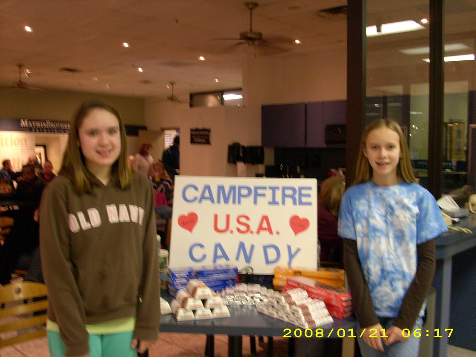 Shelby Sheets and Emily Faulkner enjoy selling candy as a team at Mathis Brothers Furniture. Contact the Heart of Oklahoma Council if you would like to purchase Camp Fire USA candy, 405-478-5646. Community Photo By: Cindy Faulkner Submitted By: Keri, Oklahoma City