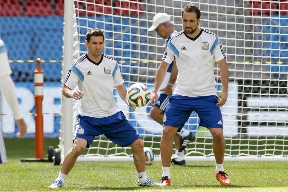 Photo - Argentina's Lionel Messi, left, and Argentina's Gonzalo Higuain take part in a training session at Estadio Nacional in Brasilia, Brazil, Friday, July 4, 2014. On Saturday, Argentina will face Belgium in their World Cup quarterfinals soccer match. (AP Photo/Eraldo Peres)