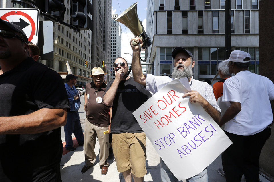 Photo - Protesters rally in downtown Detroit Monday, Aug. 19, 2013. Deadline day arrived Monday for creditors to oppose Detroit's request for bankruptcy protection, the largest municipal filing in U.S. history and one aimed at digging the city out of billions of dollars in debt. Judge Steven Rhodes set Monday as the eligibility objection deadline in the bankruptcy petition by Detroit emergency manager Kevyn Orr. Creditors,  including bond holders, insurers, banks, employee pension funds, individuals and companies that provided services, have until just before midnight to file objections electronically. (AP Photo/Paul Sancya)