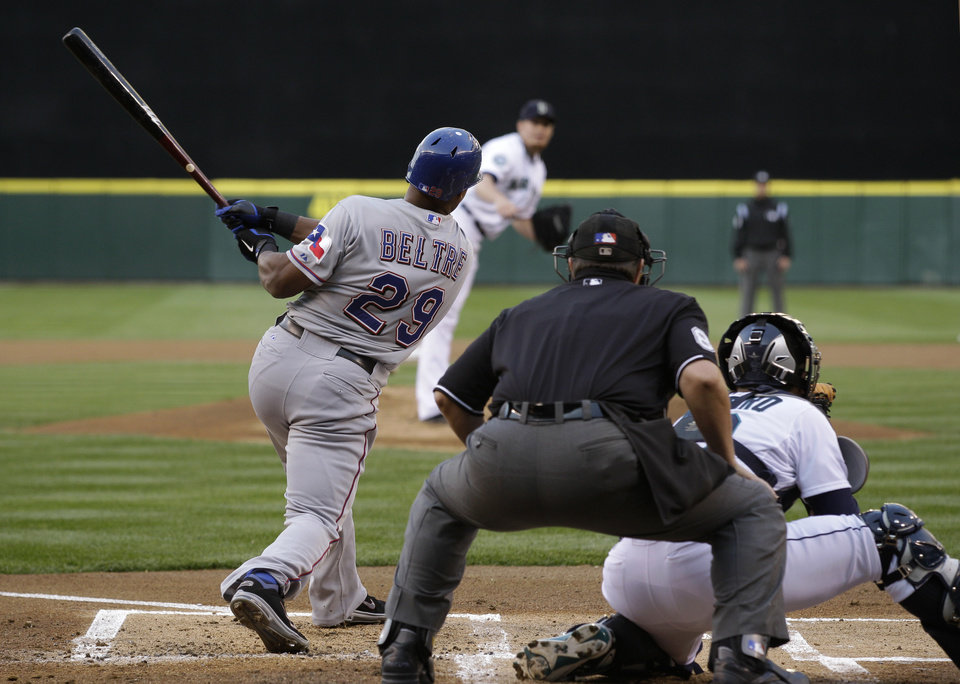 Photo -   Texas Rangers' Adrian Beltre flies out in the first inning of a baseball game against the Seattle Mariners baseball game, Saturday, Sept. 22, 2012, in Seattle. Beltre re-joined the team after being away Friday with a medical issue. (AP Photo/Ted S. Warren)