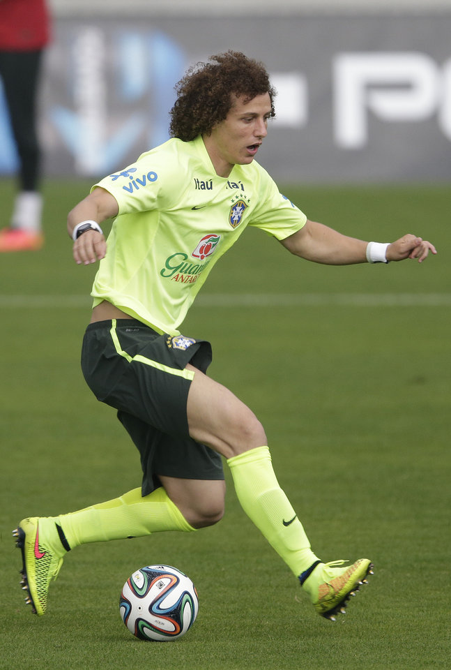 Photo - Brazil's David Luiz practices during a training session of the Brazilian national soccer team, at the Granja Comary training center in Teresopolis, Brazil, Monday, June 9, 2014. Brazil plays in group A of the 2014 soccer World Cup. (AP Photo/Andre Penner)