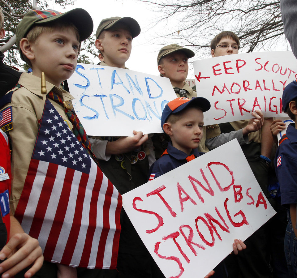 Clockwise from left,  Boy Scouts Eric Kusterer, Jacob Sorah, James Sorah, Micah Brownlee and Cub Scout John Sorah hold signs at the �Save Our Scouts� Prayer Vigil and Rally in front of the Boy Scouts of America National Headquarters in Irving, Texas, Wednesday, February 6, 2013.  The Boy Scouts of America said Wednesday it needed more time before deciding whether to move away from its divisive policy of excluding gays as scouts or adult leaders.  (AP Photo/Richard Rodriguez)