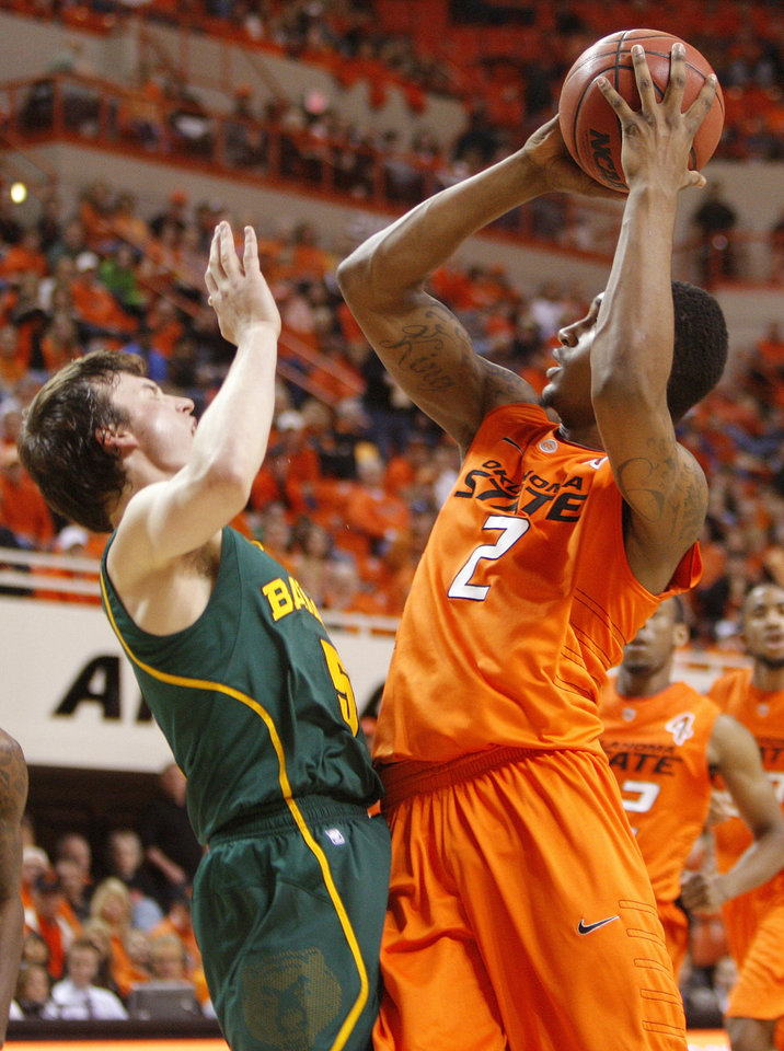 OSU's Le'Bryan Nash (2) collides with Brady Heslip (5) of Baylor in the first half of a men's college basketball game between the Oklahoma State University Cowboys and the Baylor University Bears at Gallagher-Iba Arena in Stillwater, Okla., Saturday, Feb. 4, 2012. Nash was called for an offensive foul on the play. Photo by Nate Billings, The Oklahoman