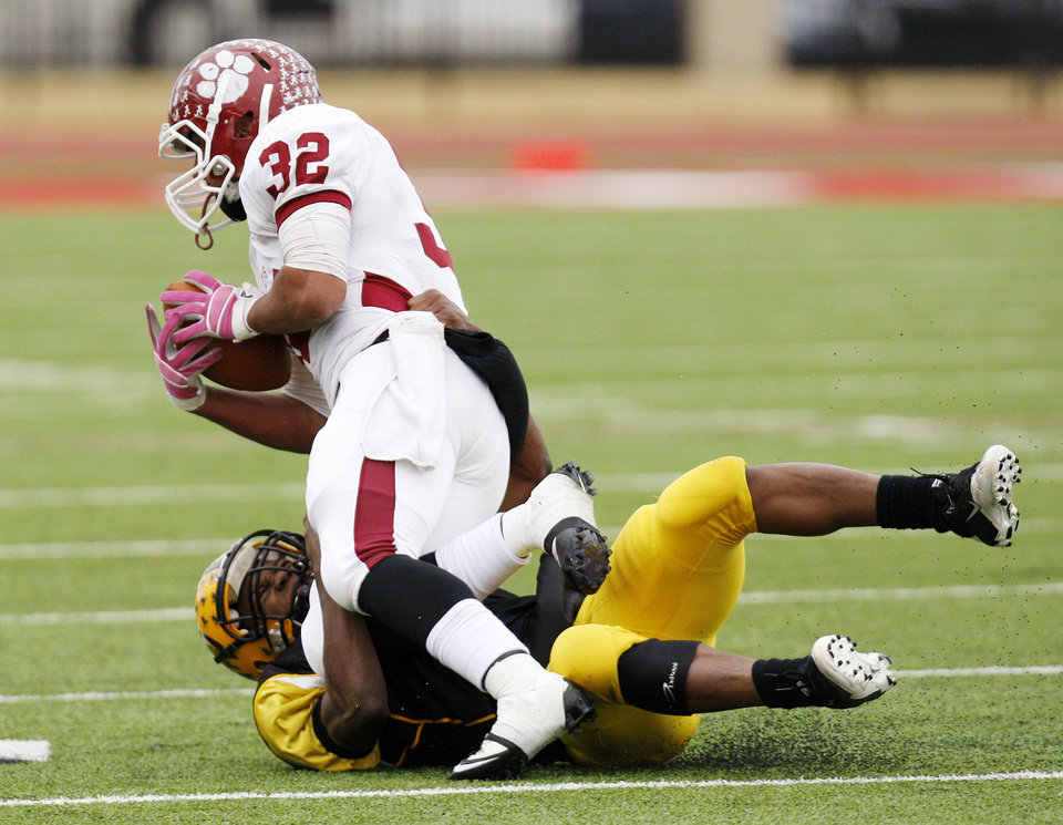Photo - Lawton MacArthur's Anthony Burris (7) tackles Tray Fish (32) of Ardmore during a high school football playoff Class 5A semifinal game between Lawton MacArthur and Ardmore in Yukon, Okla., Saturday, Nov. 26, 2011. Photo by Nate Billings, The Oklahoman