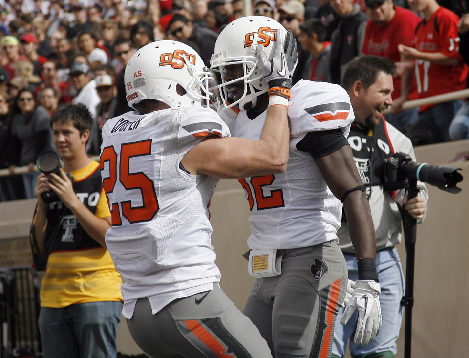 Oklahoma State's Josh Cooper (25) and Isaiah Anderson (82) celebrate a touchdown during a college football game between Texas Tech University (TTU) and Oklahoma State University (OSU) at Jones AT&T Stadium in Lubbock, Texas, Saturday, Nov. 12, 2011.  Photo by Sarah Phipps, The Oklahoman  ORG XMIT: KOD