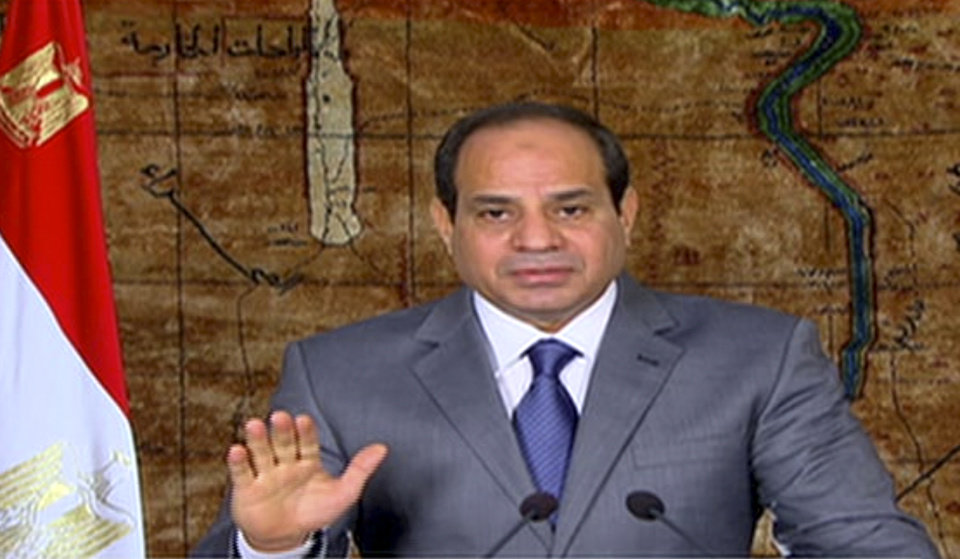 """Photo - In this image made from video broadcast on Egypt's State Television, Egyptian President Abdel-Fattah el-Sissi speaks in a nationally televised broadcast in Cairo, Egypt, Monday, July 7, 2014. El-Sissi has defended his recent decisions to partially lift subsidies on fuel, calling them a necessary """"bitter pill"""" and he couldn't delay such decisions even if it cost him support because """"the dangers are great"""" for Egypt's economy. He urged Egyptians to bear the austerity measures and appealed to the rich to donate to Egypt's development. (AP Photo/Egypt's State Television)"""