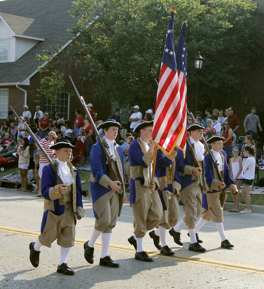 Revolutionary War reenactors march during the annual LibertyFest Fourth of July Parade in downtown Edmond, OK, Thursday, July 4, 2013,  Photo by Paul Hellstern, The Oklahoman