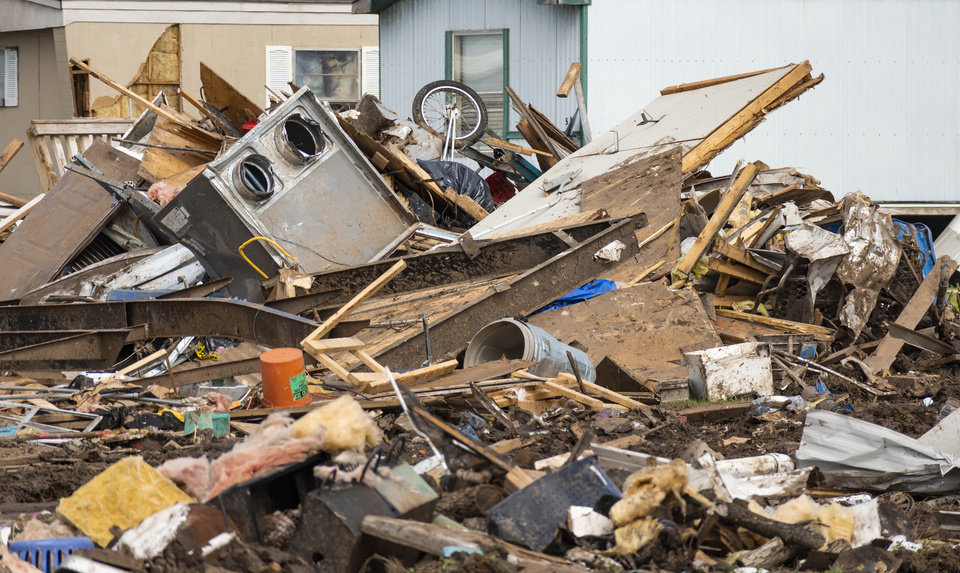 Photo - Storm damage and debris left behind at the Skyview Mobile Home Park in the aftermath of a tornado in El Reno, Okla. on Monday, May 27, 2019.The EF3 tornado hit the area on Saturday night killing two people and injuring many others. [Chris Landsberger/The Oklahoman]