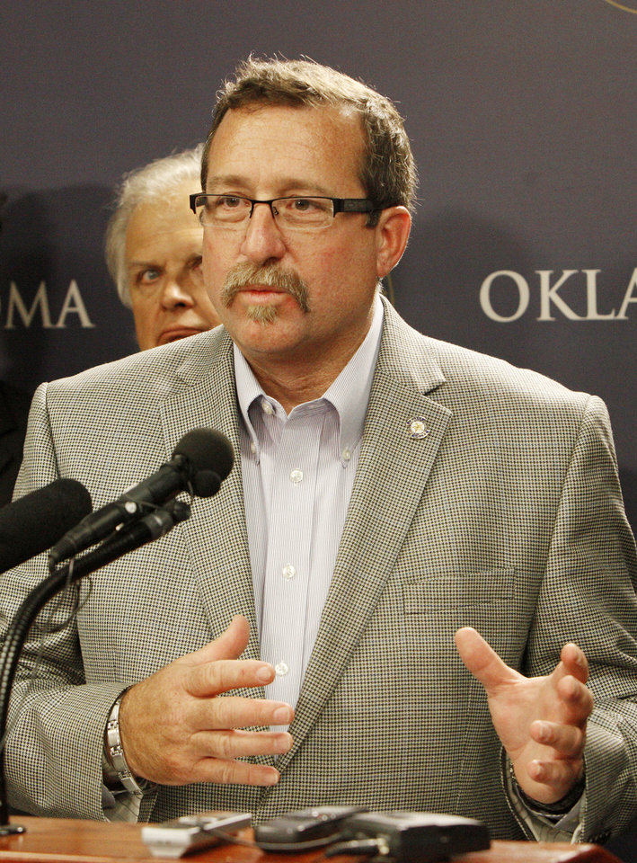 Photo - Rep. Mark McBride speaks Thursday during a press conference announcing the formation of Shelter Oklahoma Schools. McBride and state Reps. Jon Echols,  Richard Morrissette, Eric Proctor and John Trebilcock formed the entity with the purpose of helping provide storm shelter or safe rooms for existing schools. Photo by Paul B. Southerland, The Oklahoman  PAUL B. SOUTHERLAND - PAUL B. SOUTHERLAND