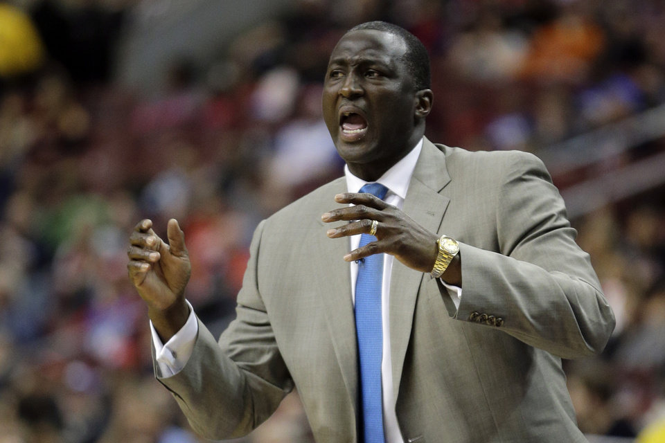 Utah Jazz head coach Tyrone Corbin reacts to a play in the first half of an NBA basketball game against the Philadelphia 76ers, Friday, Nov. 16, 2012, in Philadelphia. (AP Photo/Matt Slocum)