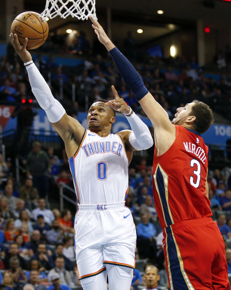 Photo - Oklahoma City's Russell Westbrook (0) shoots as New Orleans' Nikola Mirotic (3) defends during an NBA basketball game between the Oklahoma City Thunder and the New Orleans Pelicans at Chesapeake Energy Arena in Oklahoma City, Monday, Nov. 5, 2018. Photo by Nate Billings, The Oklahoman