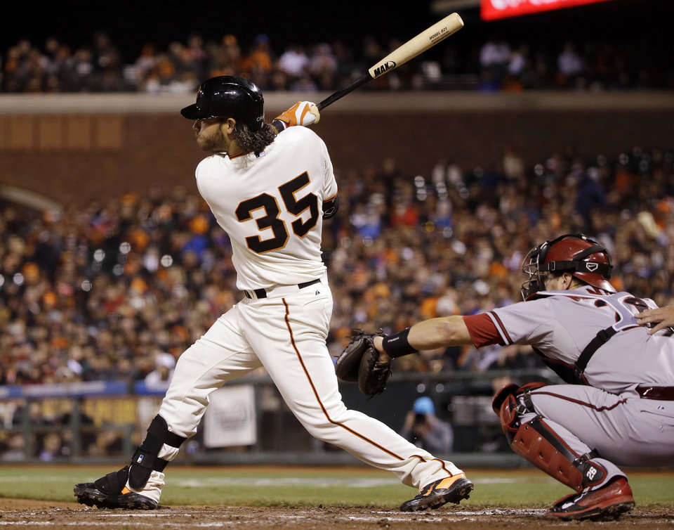 Photo - San Francisco Giants' Brandon Crawford drives in a run with a double against the Arizona Diamondbacks during the fourth inning of a baseball game on Thursday, April 10, 2014, in San Francisco. (AP Photo/Marcio Jose Sanchez)