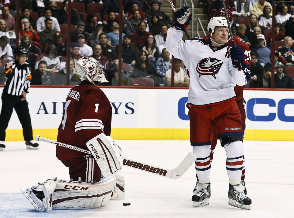 Columbus Blue Jackets' Derek Dorsett, right, celebrates a goal against Phoenix Coyotes' Jason LaBarbera (1) by teammate Fedor Tyutin during the second period in an NHL hockey game on Wednesday, Jan. 23, 2013, in Glendale, Ariz. (AP Photo/Ross D. Franklin)