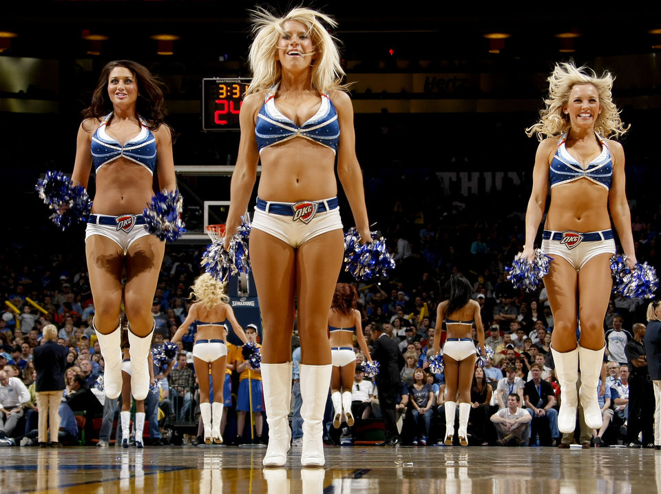 Photo - The Thunder Girls dance team performs during the NBA basketball game between the Oklahoma City Thunder and the Los Angeles at the Oklahoma City Arena, Wednesday, April 6, 2011. Photo by Bryan Terry, The Oklahoman