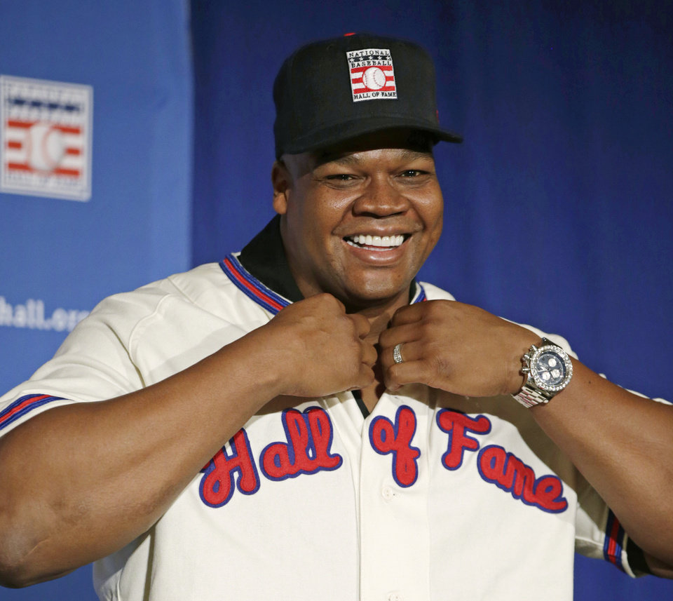 Photo - Former Chicago White Sox slugger Frank Thomas dons his Hall of Fame cap and jersey during a press conference announcing his election into the National Baseball Hall of Fame, Thursday, Jan. 9, 2014, in New York. Thomas will be inducted into the Hall of Fame in Cooperstown, N.Y. in July 2014. (AP Photo/Kathy Willens)