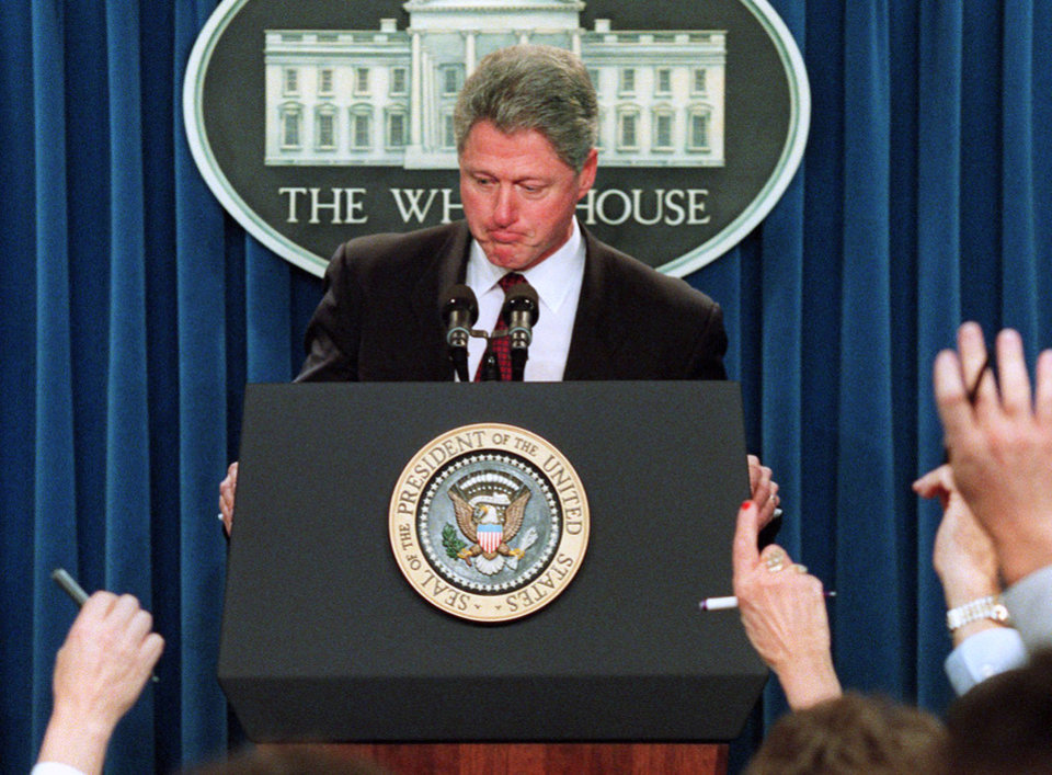 Photo - FILE – In this Jan. 3, 1996 file photo President Clinton ponders a reporters question during a  White House briefing room news conference about the federal budget impasse as the Republican House held firm, rejecting a move to end the 19-day partial government shutdown. The president condemned the defiance and continued impasse,  and called it then