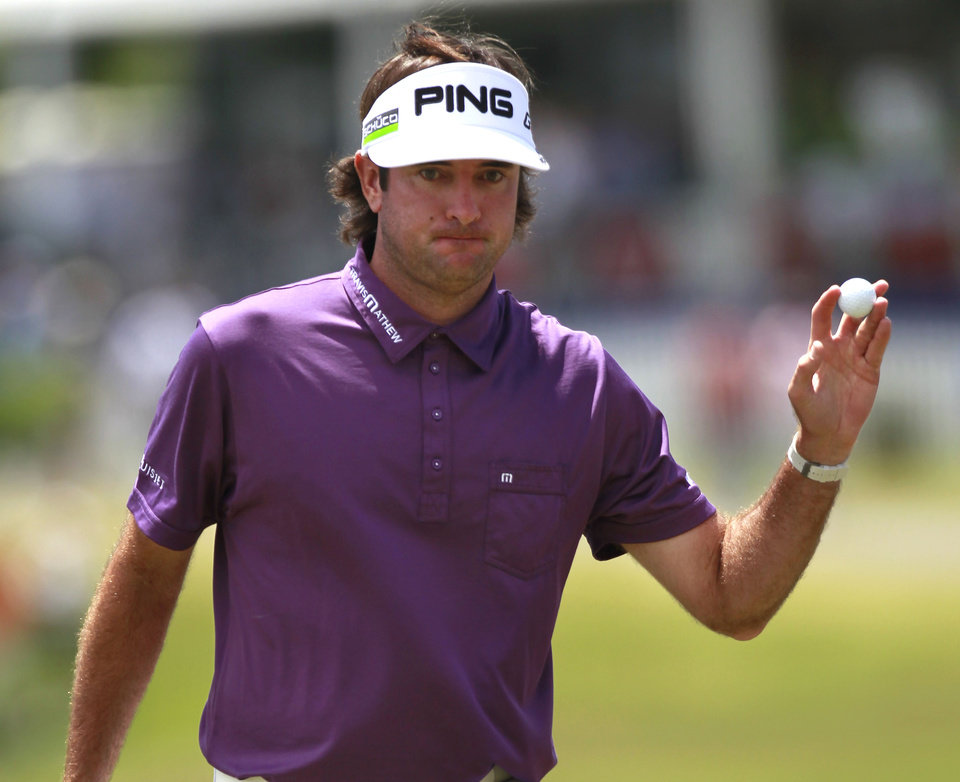 Bubba Watson reacts after making birdie on the 18th hole during the third round of the Zurich Classic golf tournament at TPC Louisiana in Avondale, La., Saturday, April 28, 2012. (AP Photo/Gerald Herbert)