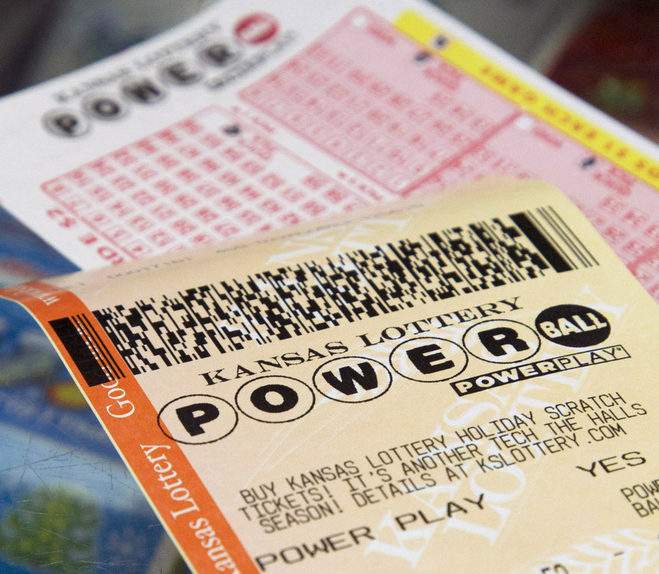 Photo - FILE - In this Friday, Nov. 23, 2012 file photo, a Powerball form and purchased ticket are on the counter at the Jayhawk Food Mart in Lawrence, Kan. A single ticket sold in New Jersey matched all six numbers in the Saturday night, March 23, 2013 drawing for the $338.3 million Powerball jackpot, lottery officials said. (AP Photo/Orlin Wagner, File)