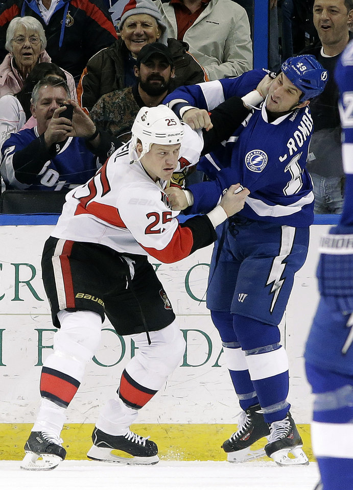 Photo - Ottawa Senators right wing Chris Neil (25) fights Tampa Bay Lightning right wing B.J. Crombeen (19) during the first period of an NHL hockey game Thursday, Jan. 23, 2014, in Tampa, Fla. Both players received five-minute fighting penalties. (AP Photo/Chris O'Meara)