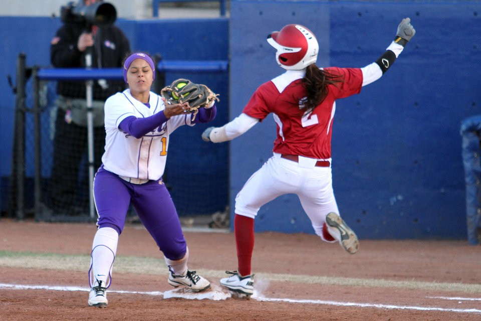 "LSU first baseman Rikki Alcaraz makes the catch to get out OU runner Brianna Turang during the University of Oklahoma - Louisiana State University game at ""The Preview"" Saturday, March 3rd, 2012 at the ASA Hall of Fame Stadium in Oklahoma City. PHOTO BY HUGH SCOTT, FOR THE OKLAHOMAN   ORG XMIT: KOD"
